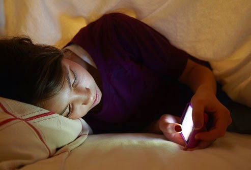 getty_rm_photo_of_teen_girl_texting_in_bed